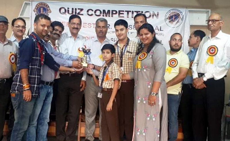 Winners of Quiz Competition organised by Lions Club being felicitated in Udhampur.