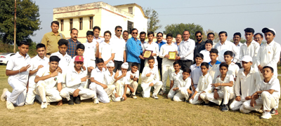 Players of winner and runner-up teams posing for photograph along with dignitaries at Sports Stadium, Hiranagar in District Kathua.