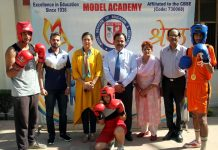 Young boxers of Model Academy displaying skill while dignitaires watch in Jammu.