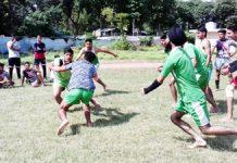 Players in action during Kabaddi match at Satwari in Jammu.
