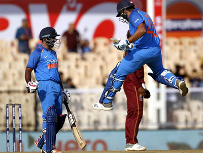 Rohit Sharma celebrates after getting to 100 in the fourth ODI against the West Indies on Monday