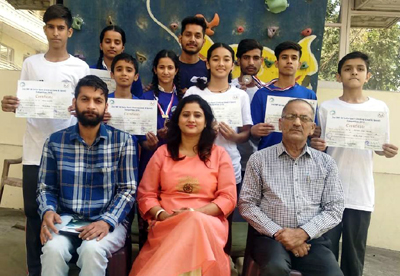 State climbers posing for a photograph with Principal of Apple Kids Arti Sharma and General Secretary Mountaineering Association of J&K Ram Khajuria on their return from the National Championship.