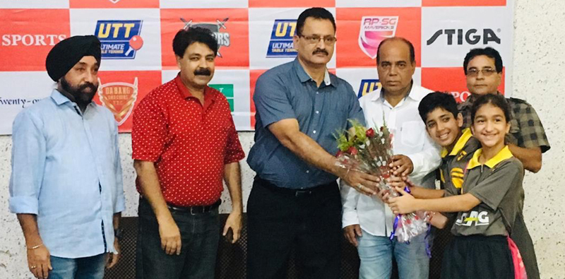 Young paddlers presenting a bouquet to Divisional Sports Officer (J) Ravi Singh during inaugural ceremony of 4th 11 Sports Interschool TT Championships.