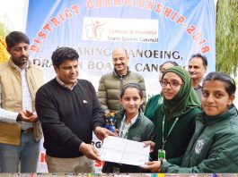 Secretary YS & Sports Sarmad Hafeez felicitating winners of Water Sports Championship in Srinagar.