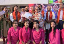 Winner team receiving award from dignitaries at Jammu on Wednesday.