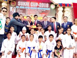 State Karatekas posing for a group photograph after winning medals in SUKAI Cup Karate Championship.