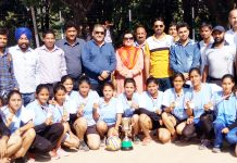 Winners of Inter-Collegiate Volleyball Tournament posing along with chief guest and other dignitaries in Jammu.