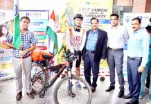 Rohan Philem being flagged off by Chancellor Shardha University PK Gupta for bicycle expedition.