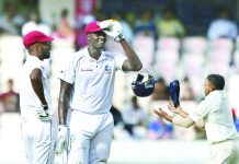 Jason Holder shares a laugh with Roston Chase during 2nd Test match against India at Hyderabad on Friday.