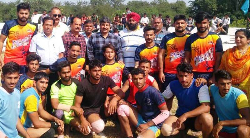 Players posing along with ADC Samba during Khelo India Competitions on Wednesday.