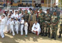Players posing along with dignitaries and officials during Baramulla Premier League on Wednesday.