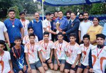 Winners of Jammu District Khelo India Handball C'ship posing along with chief guest and other dignitaries on Wednesday.