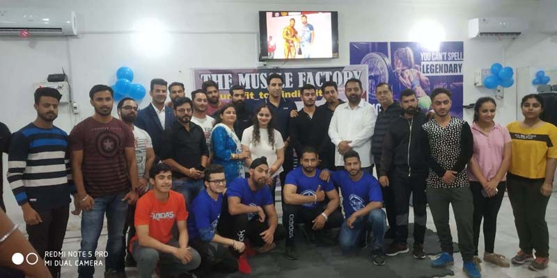 Players posing alongwith Asian Games medallist, Surya Bhanu Partap and his coach at Muscle Factory Gym in Jammu.