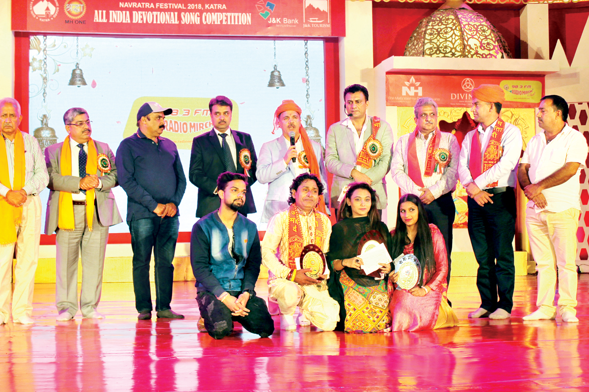 Winners of preliminary round of All India Devotional Song Competition and dignitaries posing for group photograph.