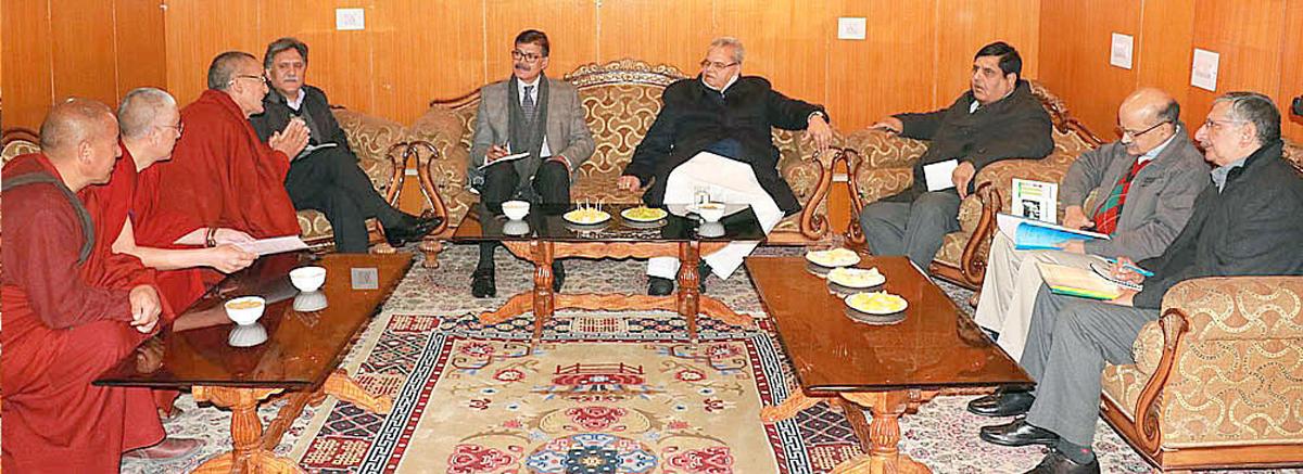 Governor Satya Pal Malik interacting with a delegation at Leh on Thursday.