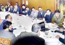 Chief Secretary BVR Subrahmanyam chairing a meeting at Srinagar on Monday.