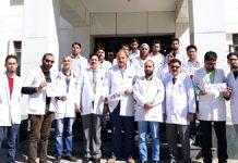Doctors staging protest at District Hospital, Doda on Monday.