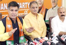 BJP State president, Ravinder Raina, former Deputy CM, Kavinder Gupta and general secretary, Yudhvir Sethi at a press conference at Jammu on Wednesday. -Excelsior/ Rakesh