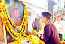 Dr Karan Singh paying floral tributes to Maharaja Gulab Singh on his birth anniversary.