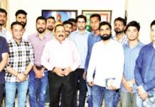 Union Minister Dr Jitendra Singh in an informal interaction with a group of PhD and Research Scholars from Jammu University, on Monday.