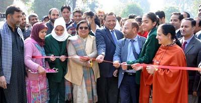 Chief Justice Gita Mittal inaugurating plantation drive in Srinagar on Thursday.