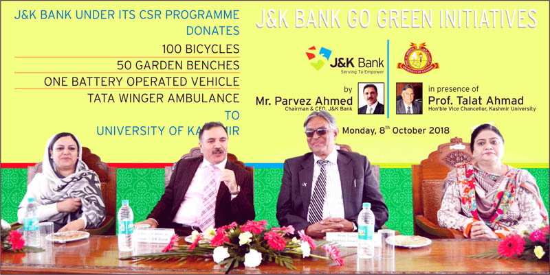 J&K Bank Chairman Parvez Ahmed, VC KU Professor Talat Ahmad and others during bank's go green initiative at KU on Monday.