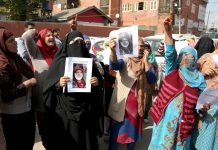 Family of torture victim protesting in Srinagar on Friday. -Excelsior/Shakeel