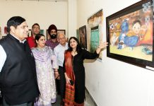 BB Vyas, Advisor to Governor having glimpse of a painting exhibited during 'Group Art Exhibition' at Jammu on Saturday. —Excelsior/Rakesh