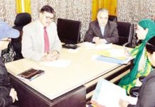 Advisor to Governor K Vijay Kumar chairing a meeting at Srinagar on Monday.