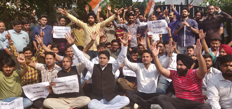 Youth Cong activists staging protest dharna outside J&K Bank head office at Railway Road in Jammu on Wednesday.
