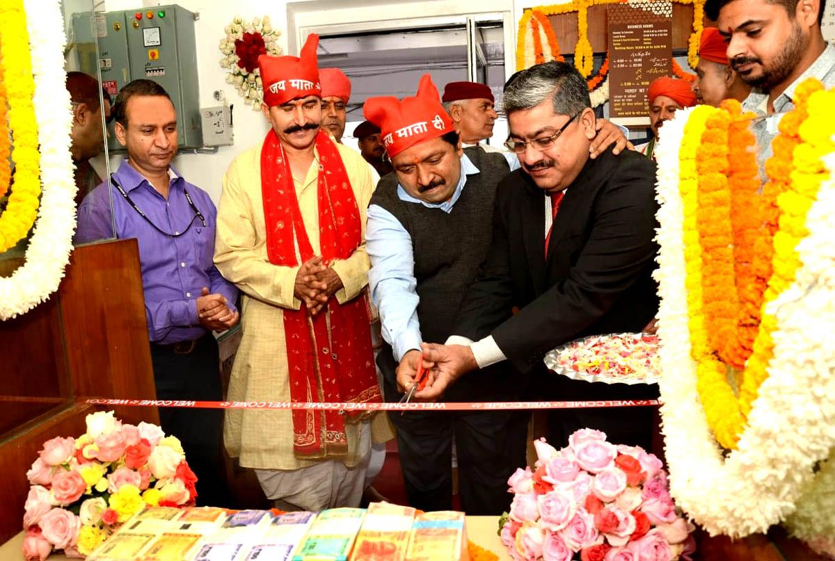 Dheeraj Gupta, CEO SMVDSB, SDM Bhawan Naresh Kumar along with others inaugurating fresh currency counter at Vaishno Devi Bhawan.