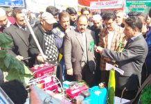 Kishore Kumar Bhagat, Principal District and Sessions Judge Kulgam along with others inspecting stalls at a Legal Awareness Camp in Kulgam on Saturday.