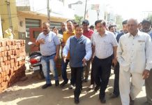 MLA Jammu West, Sat Sharma along with Executive Engineer, R&B Rajan Mengi during a tour to Shakti Nagar area on Sunday.