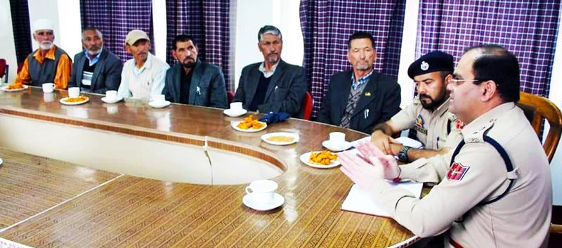 SSP Kargil Dr Vinod Kumar meeting retired police personnel in Kargil on Wednesday.