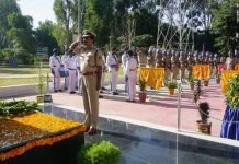 A CRPF officer paying tributes to martyrs.