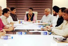 BJP State president, Ravinder Raina chairing a meeting of party office bearers at Trikuta Nagar on Monday.
