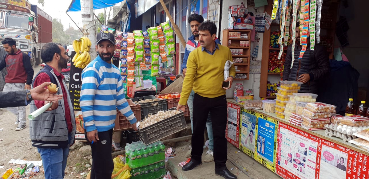 Shopian Municipal Committee team removing encroachments.