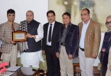 CTA delegation members posing with Governor SP Malik after a meeting at Raj Bhawan in Srinagar.