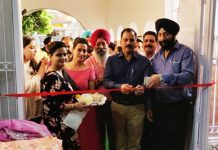 SSP Kulwant Singh Jasrotia along with SSP Tejinder Singh inaugurating Indo-Western dresses exhibition at Guru Nanak Nagar Jammu on Monday.