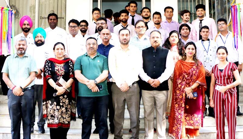 Staff of SHTM, JU along with guests and participants posing for a group photograph.