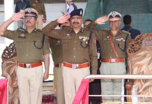 DGP Dilbagh Singh taking salute during full dress rehearsal Parade for Police Commemoration Day at Police Martyrs Memorial Zewan Srinagar on Friday.