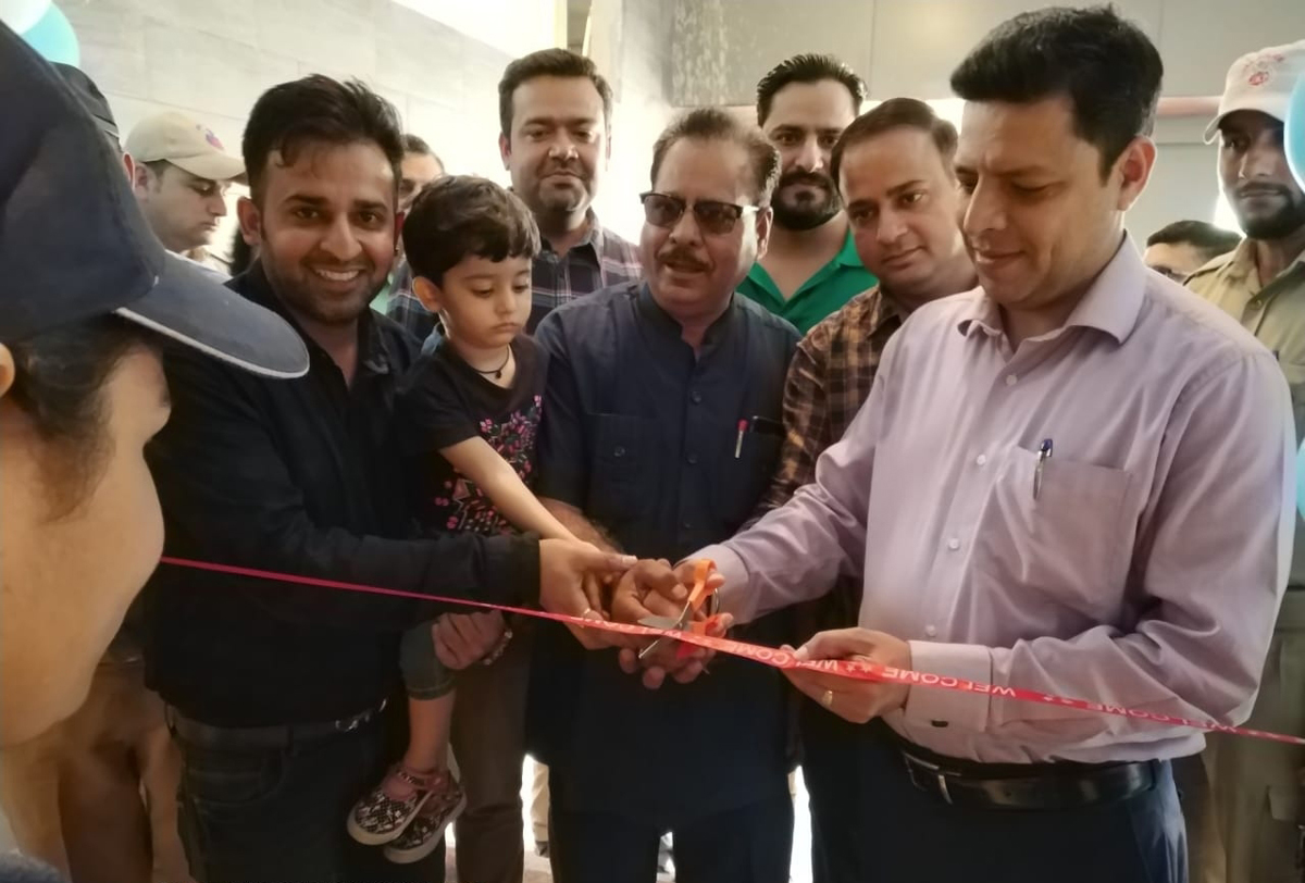Divisional Commissioner, Jammu, Sanjeev Verma, inaugurating Domino's new store at Greater Kailash, Jammu.