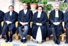 Chief Justice Gitta Mittal and other Judges posing for group photograph after farewell function of Justice M K Hanjura on superannuation on Wednesday.