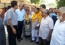 Former Minister & MLA Jammu West, Sat Sharma interacting with officers and people in Talab Tillo area on Friday.
