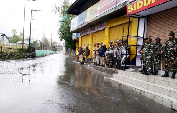 Security personnel guard a deserted street of Kishtwar town on Friday.