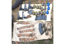 Arms and ammunition recovered from slain infiltrator in Khour sector on Tuesday.