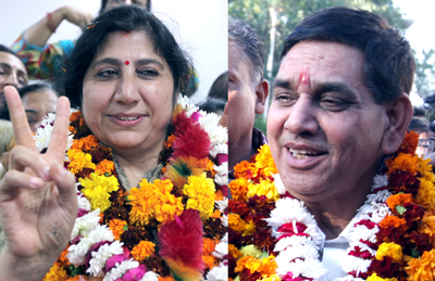 BJP leaders Chander Mohan Gupta and Purmina Sharma after being elected as Mayor and Dy Mayor of JMC on Thursday. -Excelsior/Rakesh