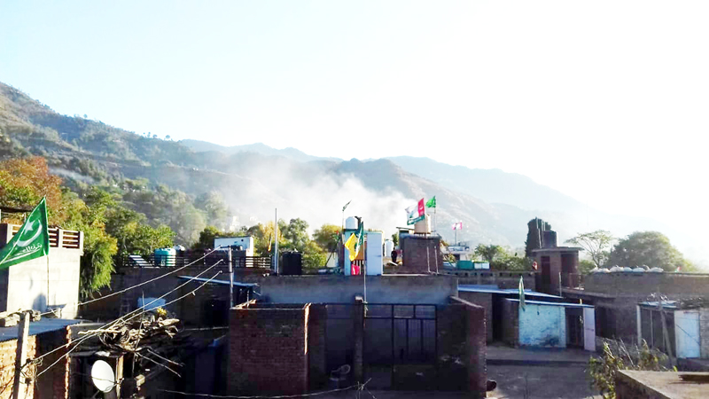 Smoke billows out of an area where rocket fired by Pakistan army exploded in Poonch town on Tuesday. -Excelsior/Harbhajan