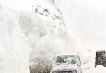 A police vehicle struck at Zojila Pass during rescue operation. -Excelsior/Shakeel