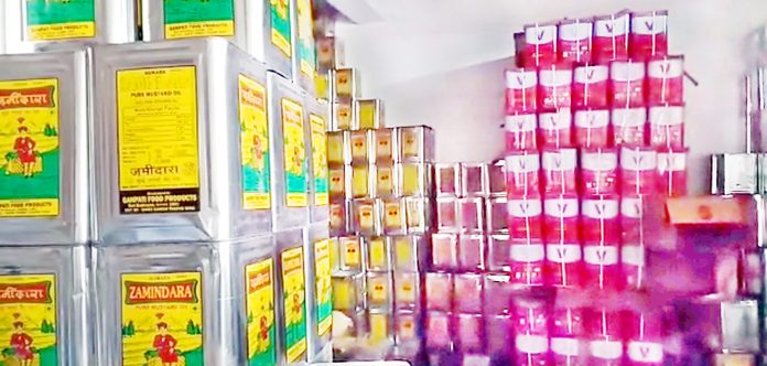 Adulterated edible oil being sold in the markets of Kashmir. -Excelsior/Sajad Dar